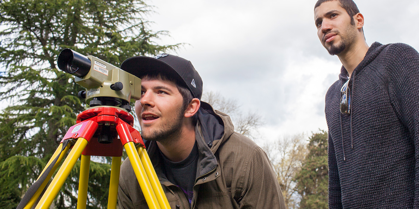Students with surveying equipment