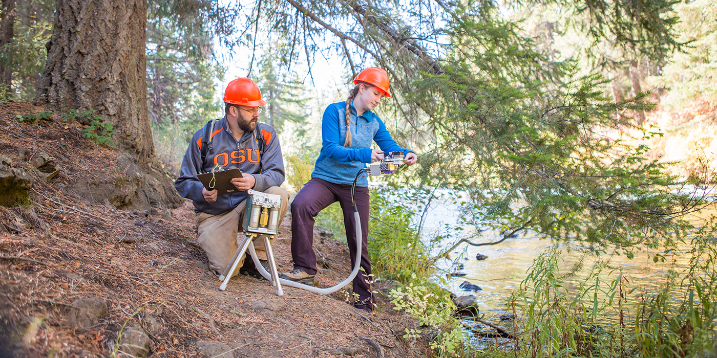 Faculty and student studying Metolius River ecosystem