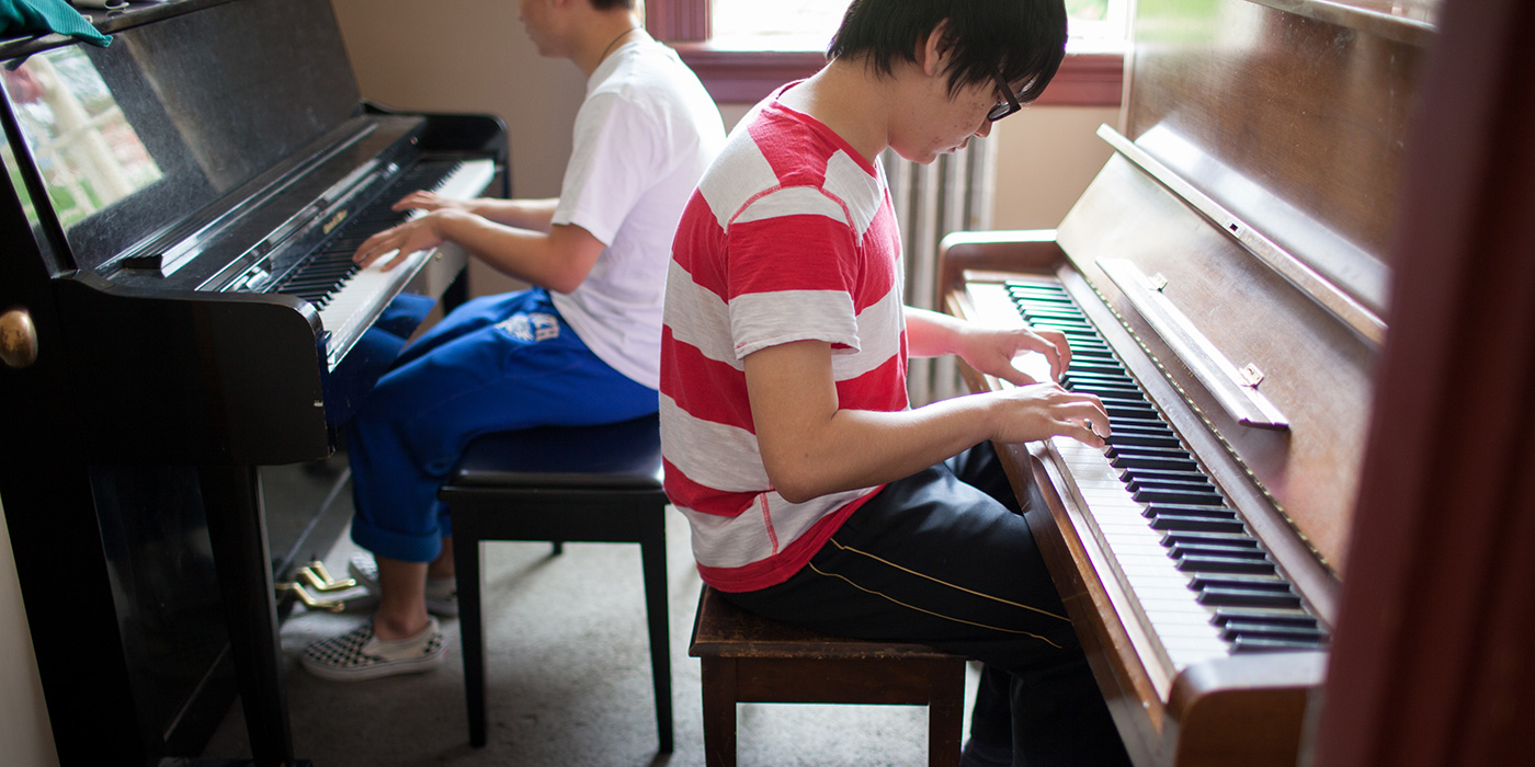 Students practicing on pianos