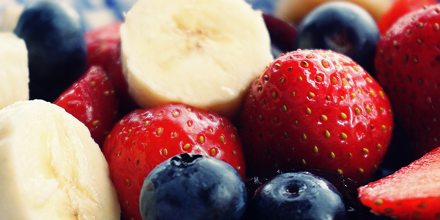 Sliced bananas, strawberries and blueberries