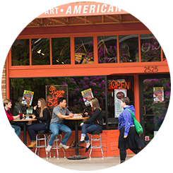 students eating in front of American Dream Pizza
